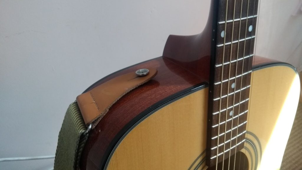 attaching guitar strap to buttons